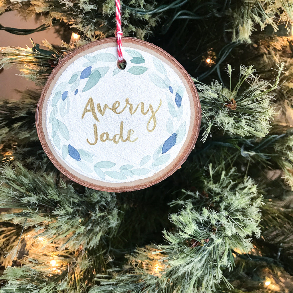 Hand lettered, hand painted watercolour on white wood ornament. Each item is custom painted by artist Kait DeWoff. $15 CAD each.