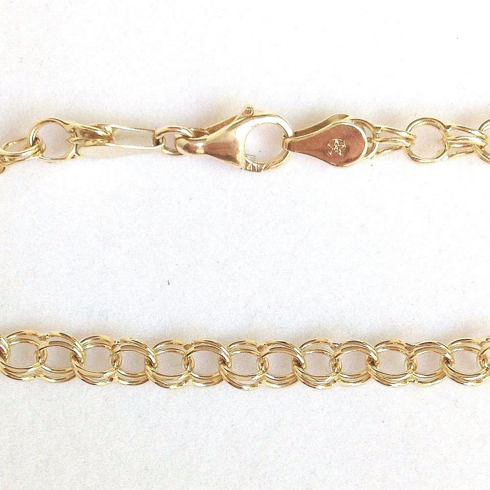 Genuine 14K yellow gold charm bracelet 7 3/4 inches 5.9 gr. NWT $860