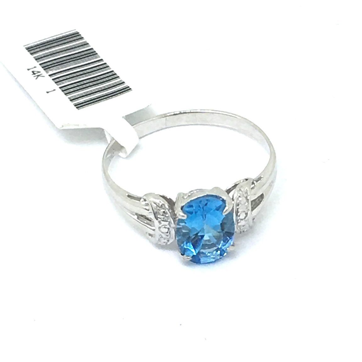 14K white gold and Genuine Oval 2.3 ct.Blue Topaz Ring $400 NWT Size 7 1/4