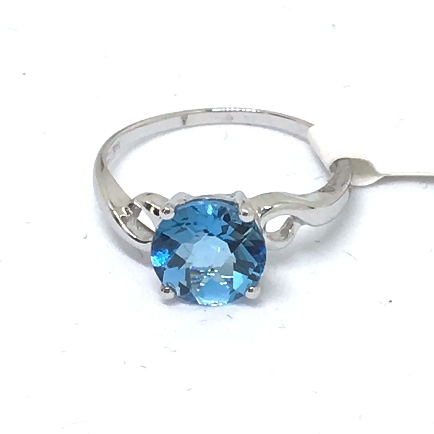 14K white gold and Genuine 2.35K Blue Topaz Ring, 2.3 grams $850 NWT Size 6 1/2