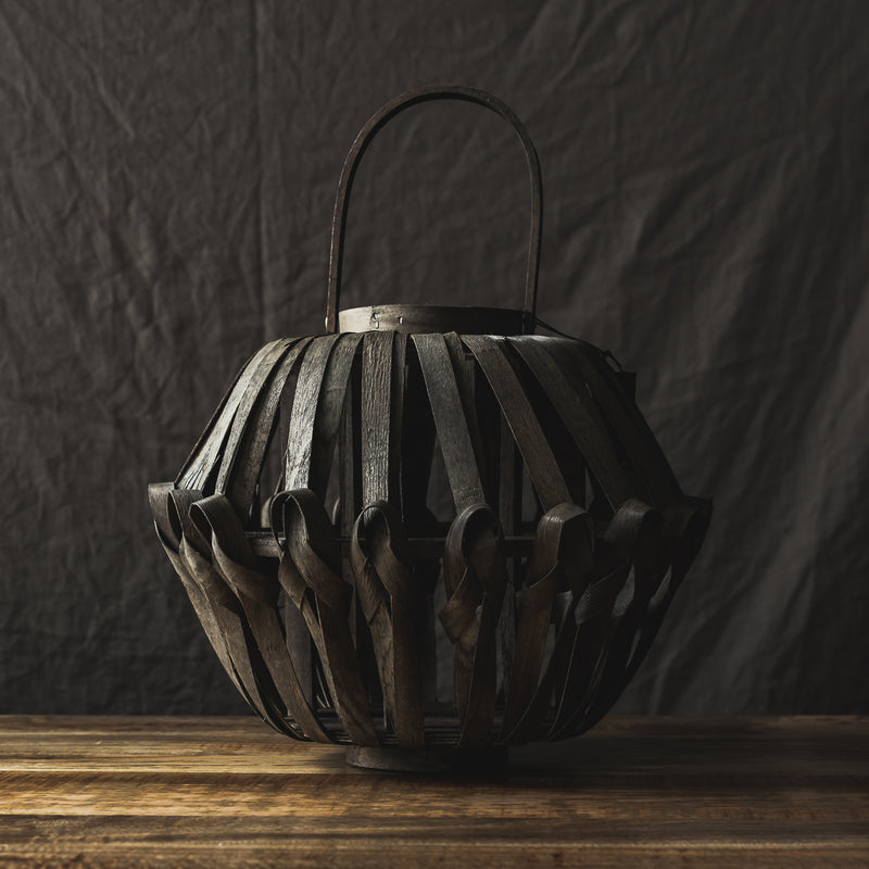 wooden weaved lantern by house doctor
