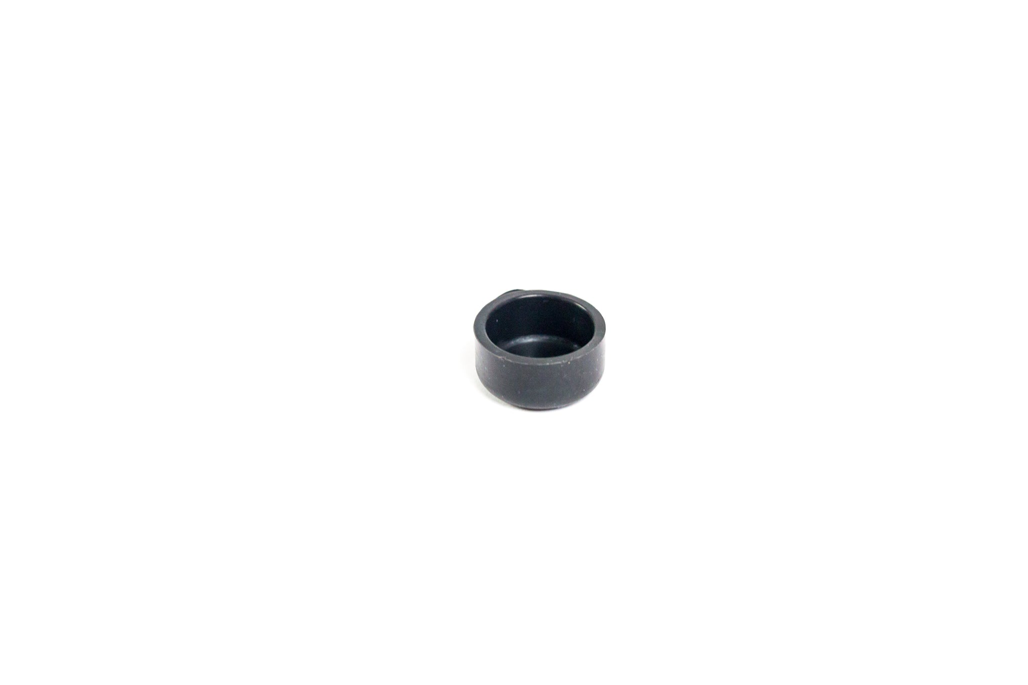 Silicone end cap for the removable check valve