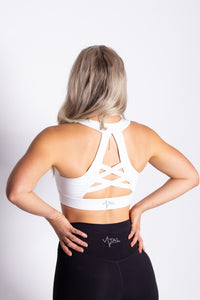 White high support strappy sports bra for working out, yoga, and crossfit!