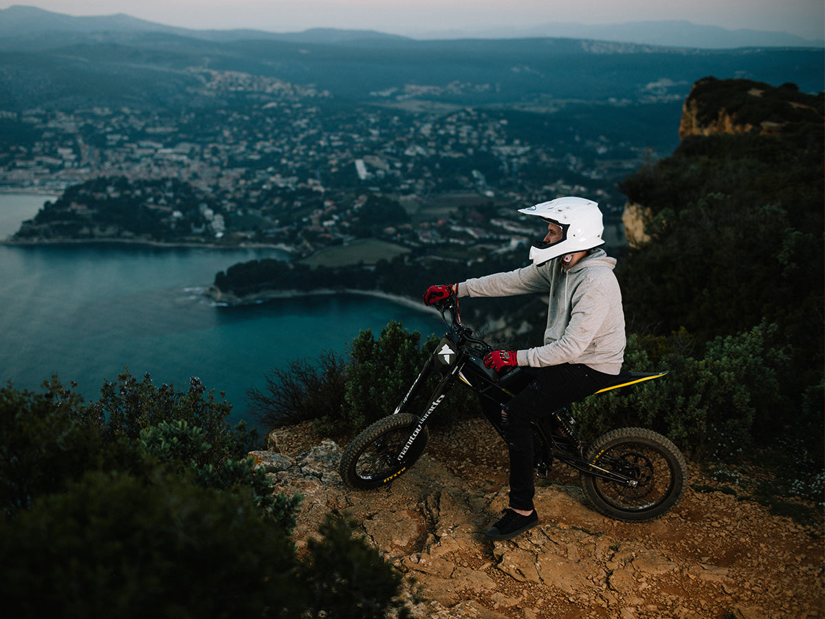 Kuberg Freerider electric dirt bike on a cliff