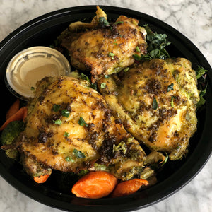 Slow roasted lemon and herb chicken thighs