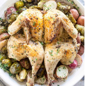 Spatchcocked Lemon-Herb roast chicken with roasted vegetables