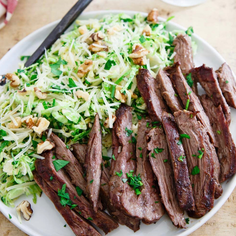 Sliced Steak with Crispy Brussels and Horseradish Sauce