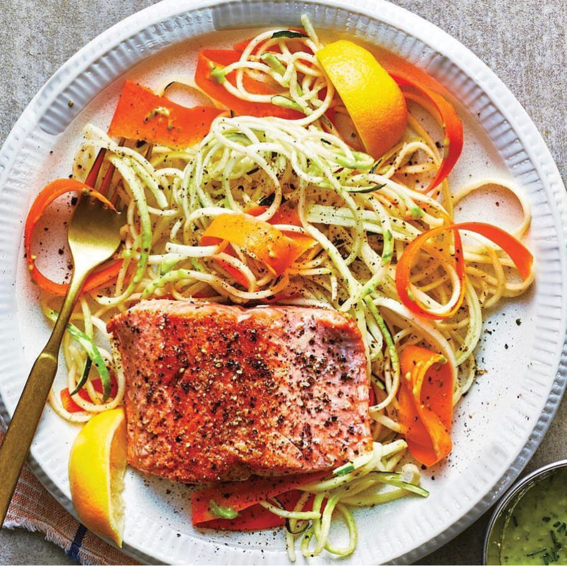 Herb roasted salmon with zucchini and carrot noodle salad