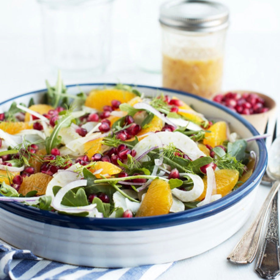Spinach Salad with roasted butternut squash, apples, dried cranberries, and citrus champagne vinaigrette