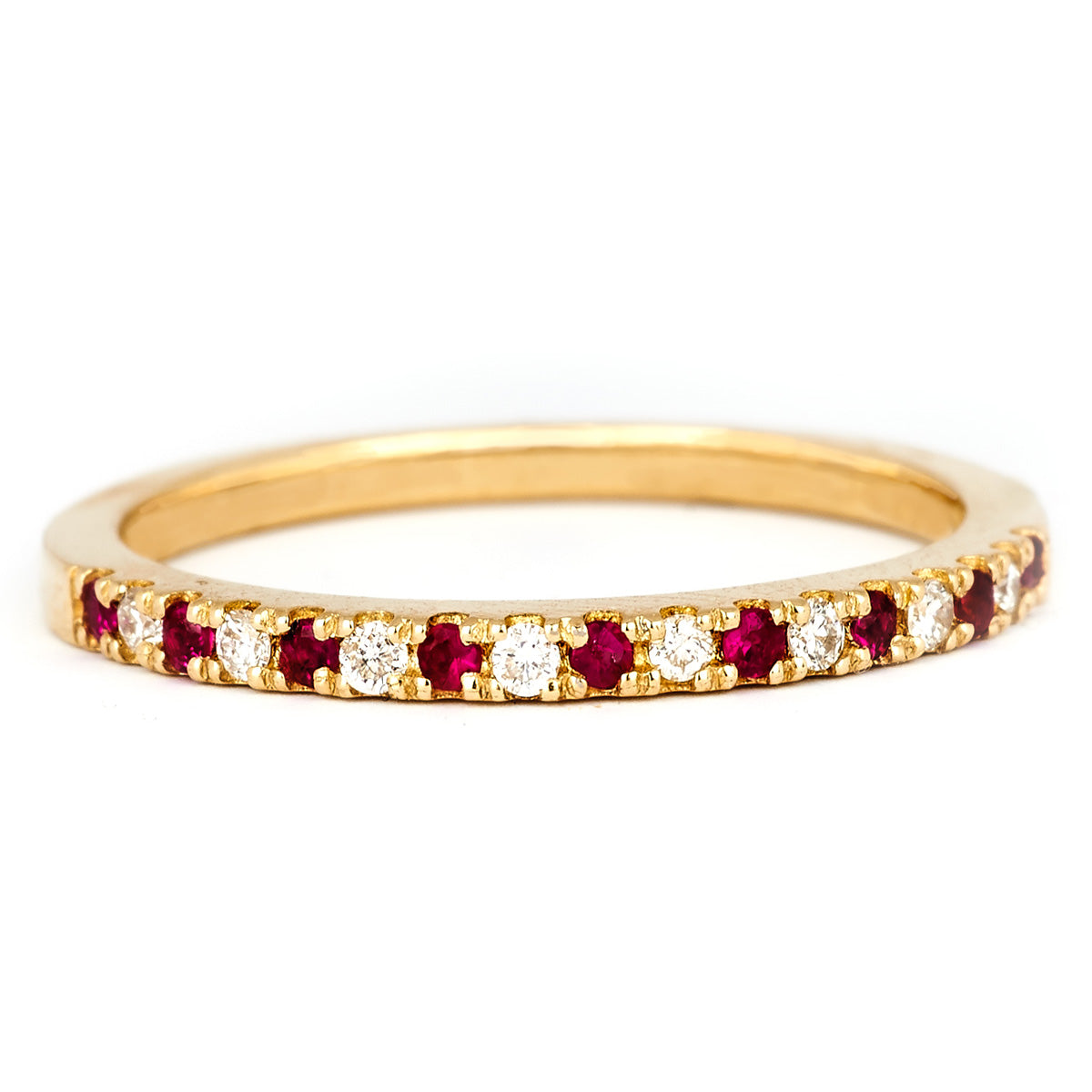 Yellow gold, diamond and ruby pavé ring by Jessica Jewellery.
