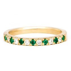 Yellow gold, diamond and emerald pavé ring by Jessica Jewellery.