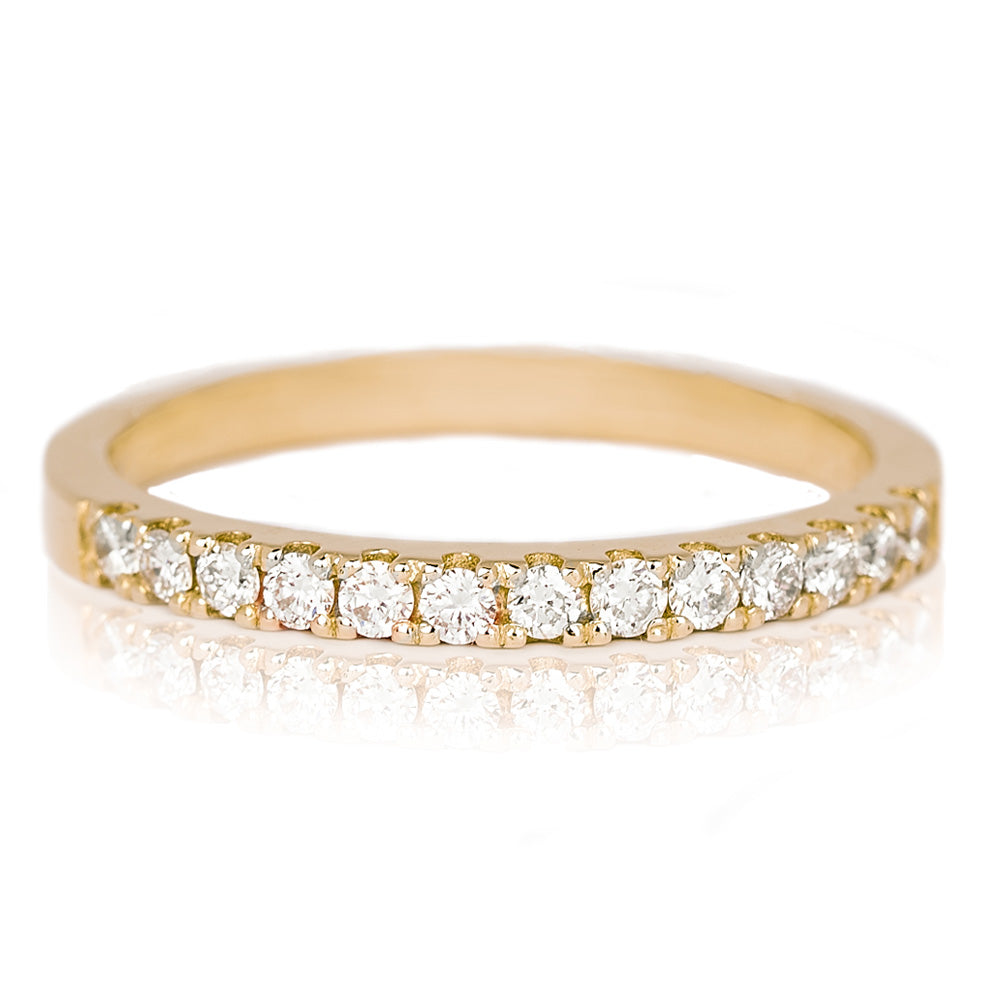 Jessica Jewellery yellow gold pavé-set half diamond ring.