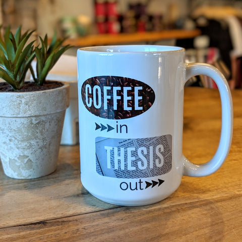 Coffee in Thesis Out mug table