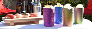 Four Craft Beer Tumblers and Sushi on a Sunny Table