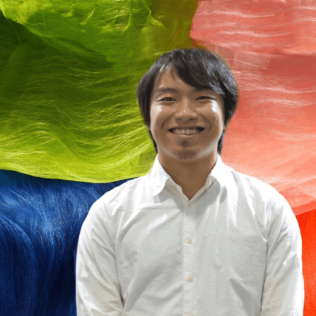 Mr. Maito Plant Dye Artist Japan with Background of Colorful Silk Stoles