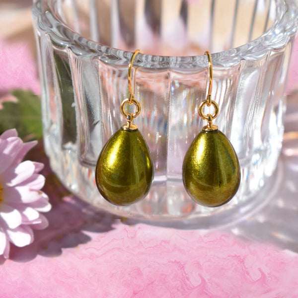Glossy Japanese Urushi Pistachio Green Pierced earrings on Pink Table