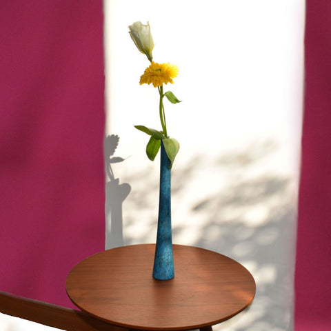 Ikebana Teal Table Vase on Table with Flowers with Maroon and White Wall
