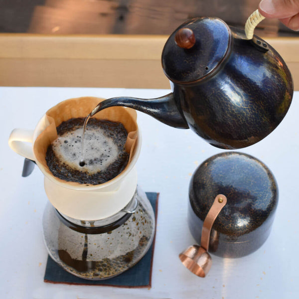 Hand-Hammered Copper Blue Patina Coffee Pot Pouring Water Over Coffee Beans