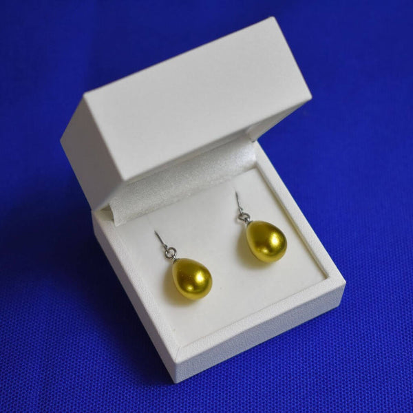 Urushi Lemon Gold Earrings Displayed in White Jewelry Box