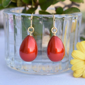 Poppy Red Lacquer Urushi Earrings Hanging on Glass Container