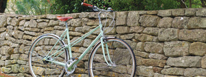 Pashley Aurora alongside an old stone wall.