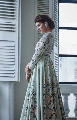Jacqueline Fernandez Wearing a mint green pleated Anarkali with embroidered floral motifs.