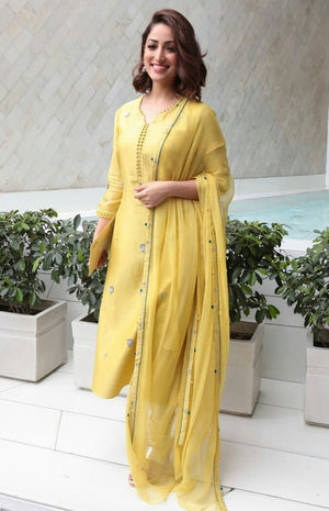 Yami Gautam Wearing a Yellow lightly embroidered suit set