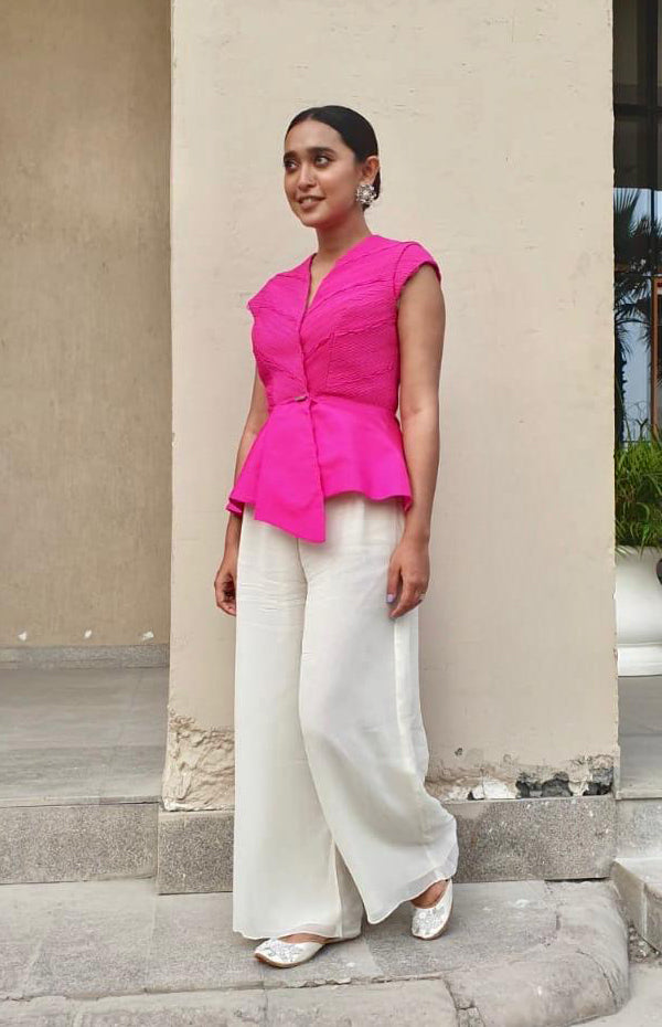 Sayani Gupta Wearing Fluorescent Pink Peplum Jacket With Subtle Loop Details