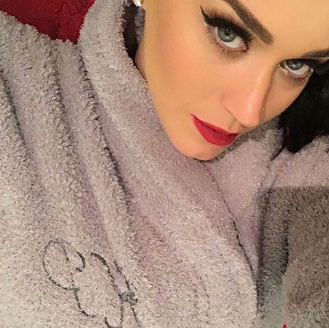 Katie Perry donning a classic monogrammed bath robe