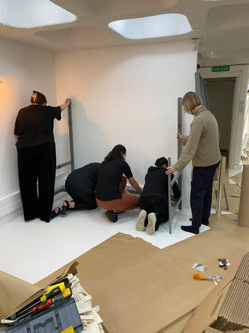Our monogramming team setting up shop in our new studio