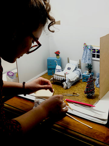 Making a miniature film set for the monogramming doll house