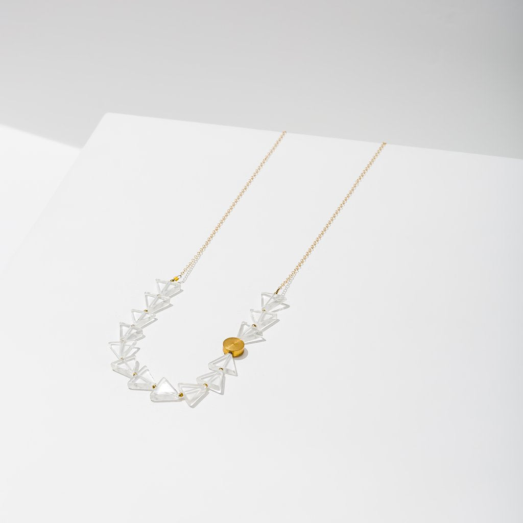 aim necklace in quartz