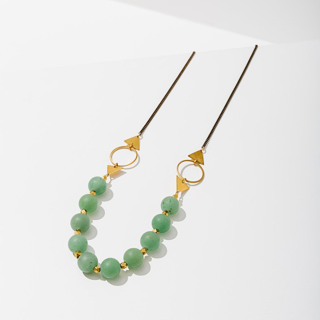shapeshifter necklace in brass with green aventurine