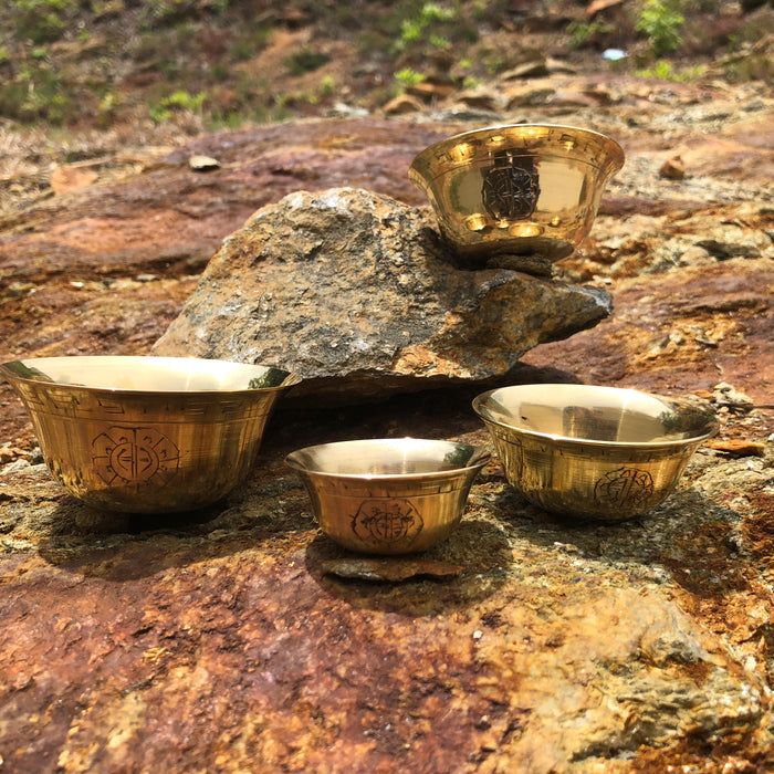 Polished brass offering bowls with design