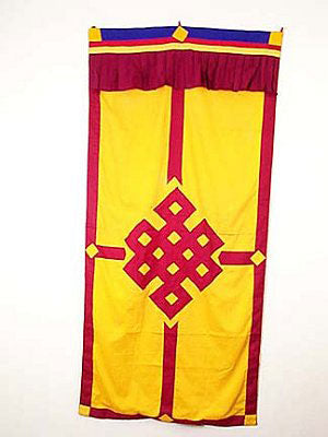 yellow door curtain w/maroon border & applique eternal knot
