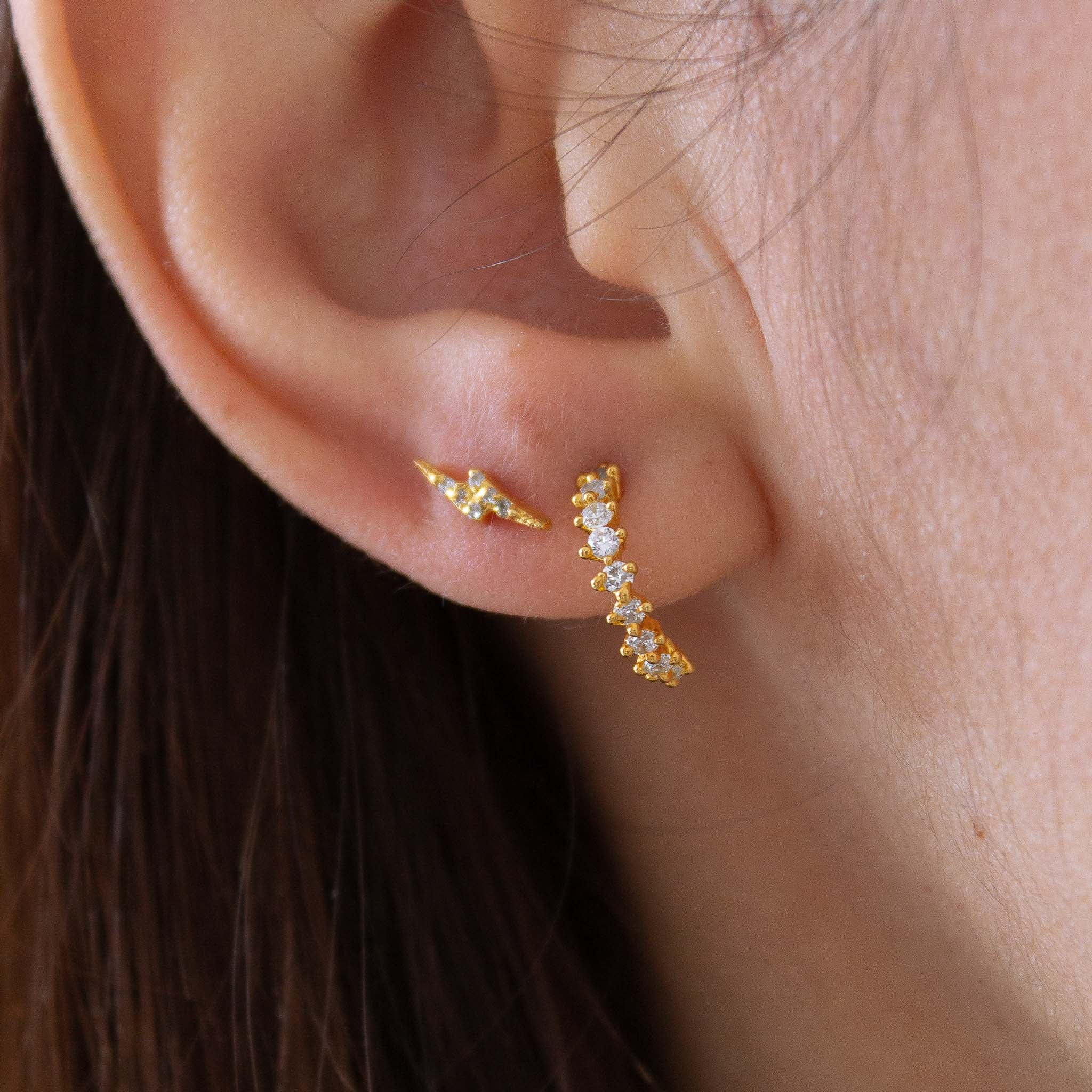 How to style a sparkly celestial earring stack.