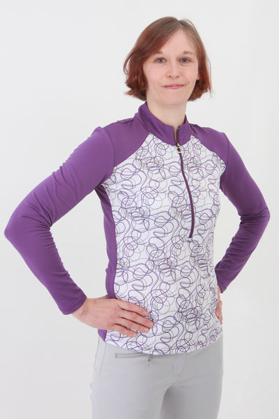A winner from JRB ladies golf, this ladies golf roll neck top is designed in a soft fabric.  For great golf clothes for women look no further than this brand.  Ladies love wearing golf clothing, especially when it makes you feel stylish. We have ladies golf clothing sales but this stock will be sold before we do.