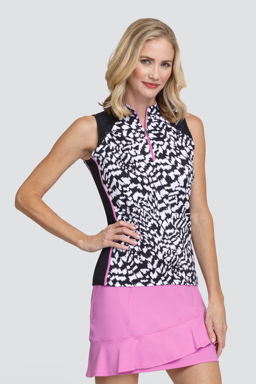 Tail Karen top - Divergence   For all you lady golfers who love a unique golfing outfit, look no further. If you want to look good and be wearing stylish ladies golfing, Tail Activewear is a brand for you. Ladies golf clothing should be stylish and comfortable. This ladies golfing polo is super stylish and will match with your golf city shorts.