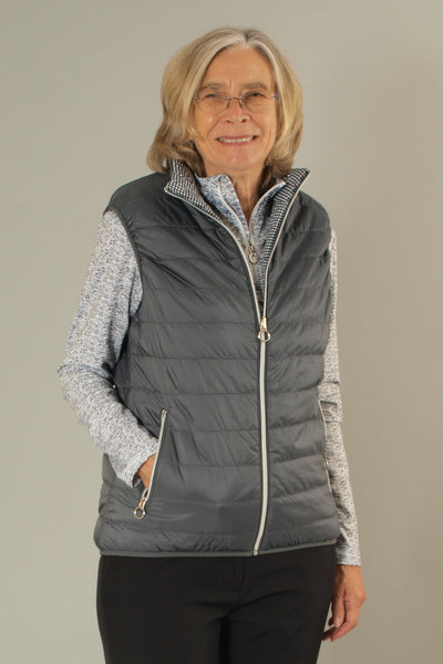 This lightweight, stylish ladies golfing gilet in graphite is a must for keeping cosy in our unpredictable weather. It's suitable for all sports and activities or just a spring stroll.  All you lady tennis players would benefit from that extra layer too.  Whatever your Daily Sport, this will fit your wardrobe.