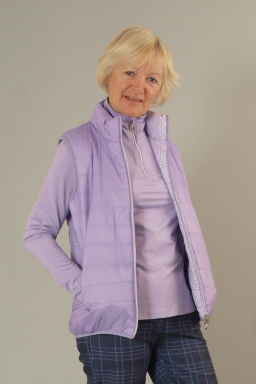 This lightweight, stylish ladies golfing gilet in lilac is a must for keeping cosy in our unpredictable weather. It's suitable for all sports and activities or just a spring stroll.  All you lady tennis players would benefit from that extra layer too.  Whatever your Daily Sport, this will fit your wardrobe.