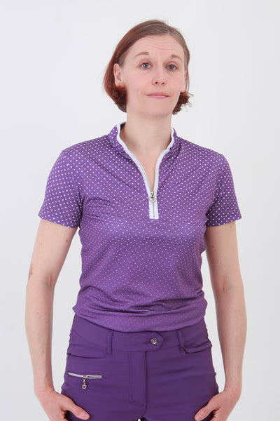 This zip necked ladies golf short sleeved polo feels silky to wear. It has a white spot pattern that will give lady golfers a stylish fashion statement to impress fellow lady golfers.  There are a number of lady golf polo shirts in the new JRB Ladies Golf range.  Sleeveless and Short Sleeved ladies golf shirts.