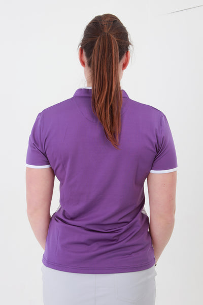 Zip necked ladies golf short sleeved polo that feels silky to wear.  The front features a purple twirl print The sleeves and shoulder areas are plain purple which continues down the back of the polo. When out partaking in your Daily Sport, whether it be with lady golfers or walkers, this purple top is a stunner.