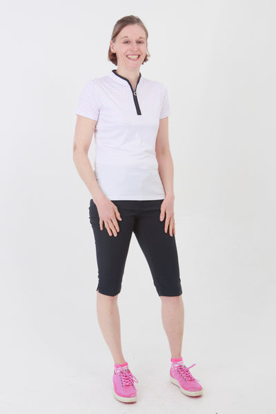 This zip necked ladies golf short sleeved polo feels silky to wear. It has a pink/blue spot pattern that will give lady golfers a stylish fashion statement to impress fellow lady golfers.  There are a number of lady golf polo shirts in the new JRB Ladies Golf range.  Sleeveless and Short Sleeved ladies golf shirts.
