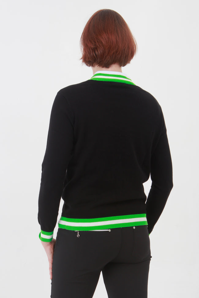 This ladies golf jumper is perfect for those early morning rounds.  Paired with the ladies golf polos from the JRB Ladies Golf collection and you will be on winning form. Ladies love golf and ladies love golf clothes.  This black golf sweater has a green trim - so stunning to wear whilst playing your Daily Sport.