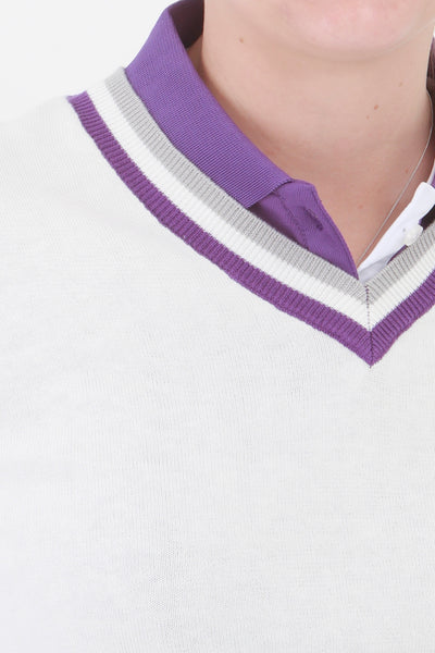 This ladies golf jumper is perfect for those early morning rounds.  Paired with the ladies golf polos from the JRB Ladies Golf collection and you will be on winning form. Ladies love golf and ladies love golf clothes.  This white golf sweater has a purple trim - so stunning to wear whilst playing your Daily Sport.
