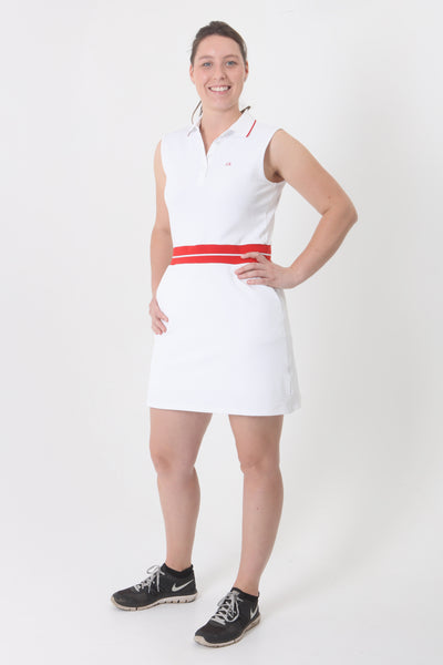"This dress is a Calvin Klein classic. Such a comfortable to wear fabric which hangs elegantly from the two red bands across the waist. This gives the impression (for the shorties amongst us) that you a little taller. Our model Charlotte is 5ft 10"". The dress comes with an under skirt and shorties which are detachable for wearing on or of the golf course and of course zip pockets. Sleeveless dress Quick drying moisture wicking fabric Detachable shorties ."