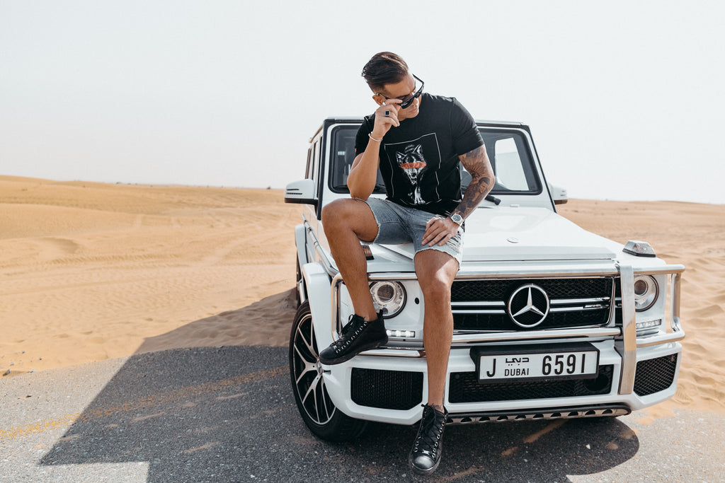 Marveli Men's Fashion in Dubai - Model Wearing Wolf Slash Black Printed T-Shirt on Mercedes-Benz SUV G-Class