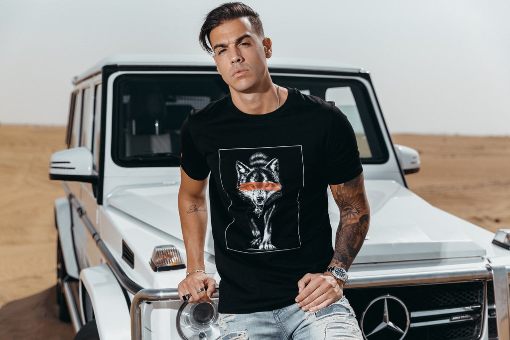 Marveli Men's Fashion in Dubai - Model Wearing Wolf Slash Black Printed 3 T-Shirt 3 on Mercedes-Benz SUV G-Class