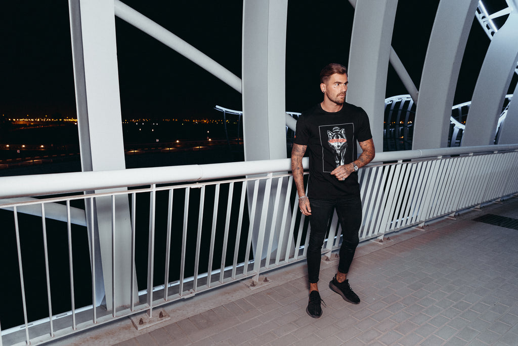 Marveli Men's Fashion in Dubai - Model Wearing Wolf Slash Black Printed T-Shirt on Bridge