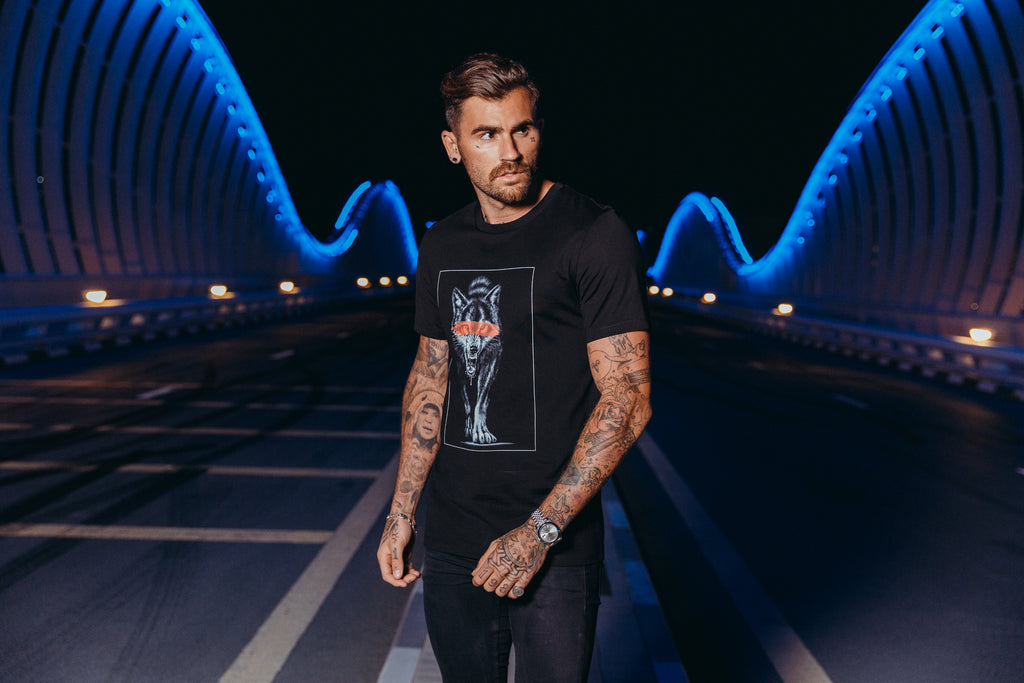 Marveli Men's Fashion in Dubai - Model Wearing Wolf Slash Black Printed T-Shirt 2 on Bridge